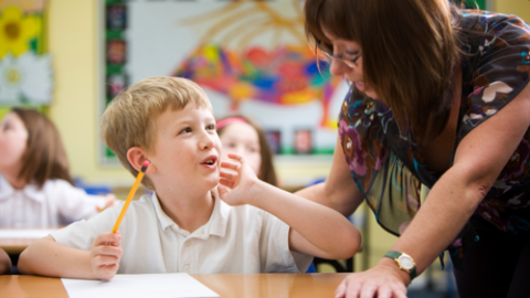 Teacher Talking Directly to Child