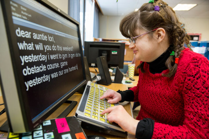 Girl using computer access AT