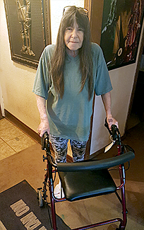 L Barkley enjoys her rollator because it helps her walk and sit down much better than crutches or cane