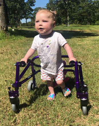 Ella using her new walker outside