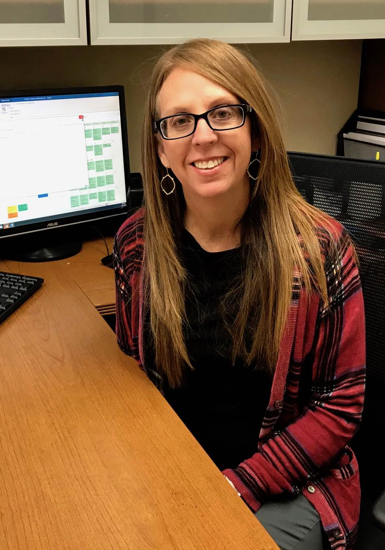 Tabatha smiling sitting at desk
