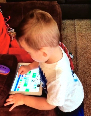 Tristan using a communication app on a tablet