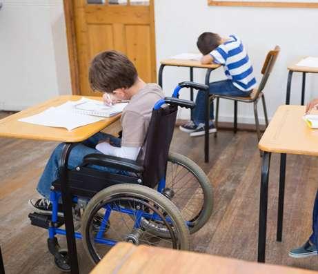 Boy in wheelchair in classroom