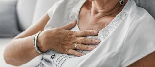 Woman with her hand on her chest