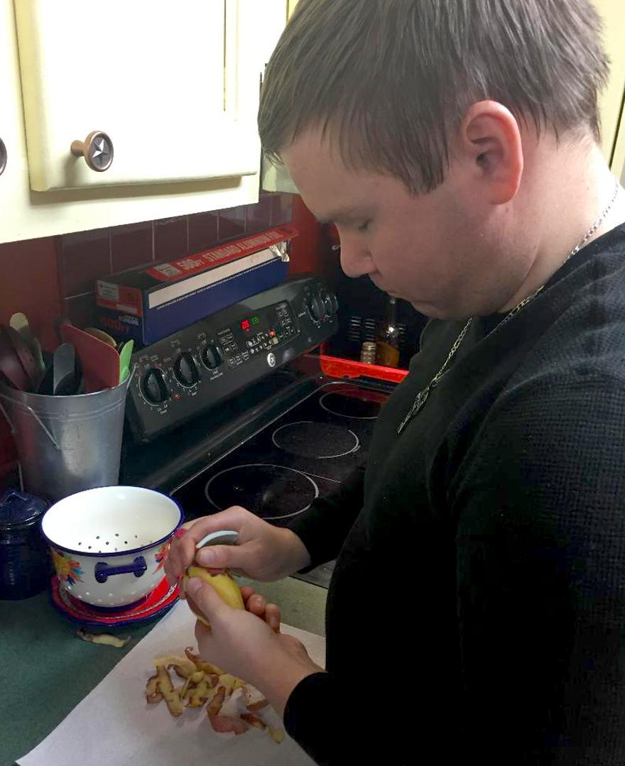 William at home preparing dinner